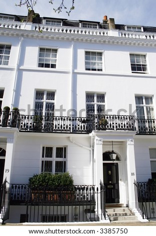 Beautiful white Georgian terraced house in Kensington, London - stock photo