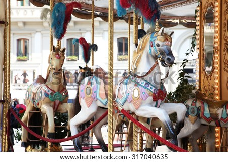 Beautiful white horses on a merry go round - stock photo