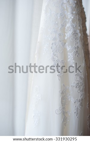 Beautiful white lace wedding Dress with white curtains background