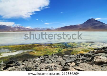 Beautiful white lake in salar de Uyuni, Bolivia desert - stock photo