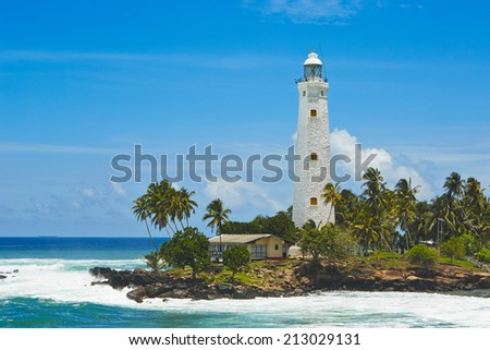 Beautiful white lighthouse in Dondra in south Sri Lanka. - stock photo