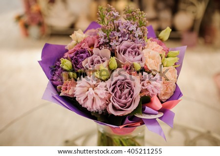 beautiful white, pink, purple flower romantic bouquet with bow - stock photo