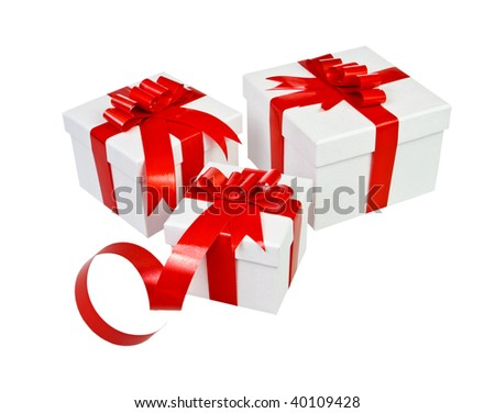 Beautiful white present gift box with red ribbon - stock photo