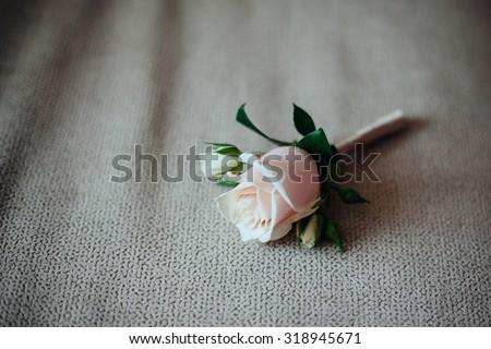 Beautiful white rose boutonniere flower. wedding buttonhole-flower - stock photo