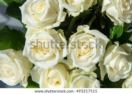 Beautiful white roses at a wedding with some decoration