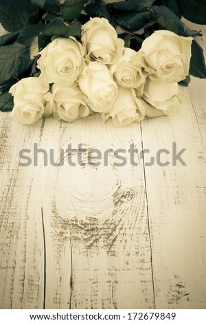 Beautiful White Roses on the Wooden Table - stock photo