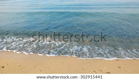 Beautiful white sand beach and tropical turquoise blue sea. View from above - stock photo