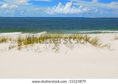 Beautiful white sand dune beach by ocean - stock photo