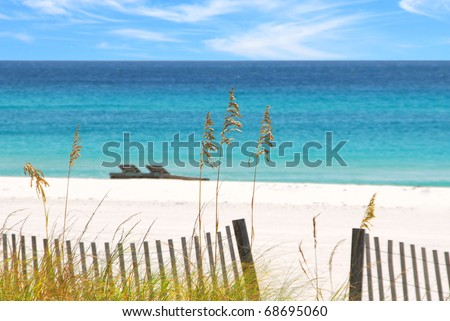 Beautiful white sands and emerald water - stock photo