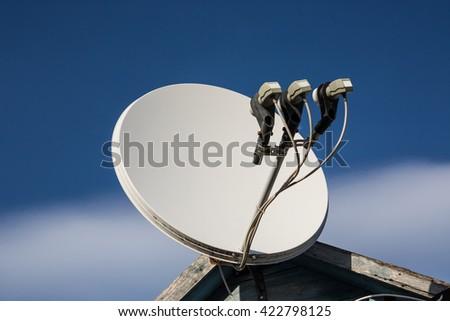 beautiful white satellite dish antennas under sky - stock photo