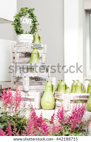 Beautiful white shelves with different gardening related objects. Summer mood - stock photo