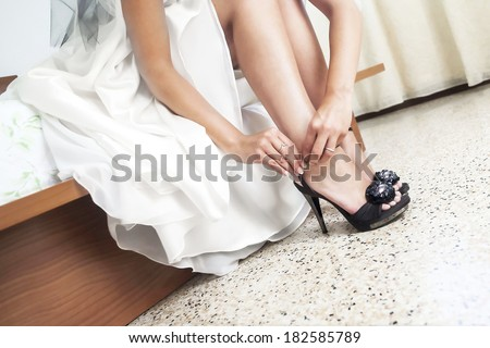 beautiful white shoes from bride - stock photo