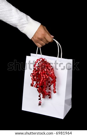 Beautiful white shopping bag on black background setting for Christmas or Valentines Day - stock photo
