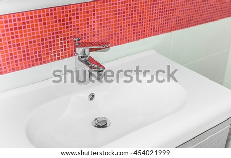 Beautiful white sink in the bathroom close up. - stock photo
