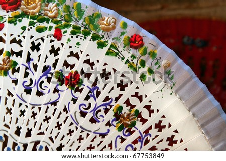 Beautiful white Spanish folding fan for sale in Segovia, Spain - stock photo