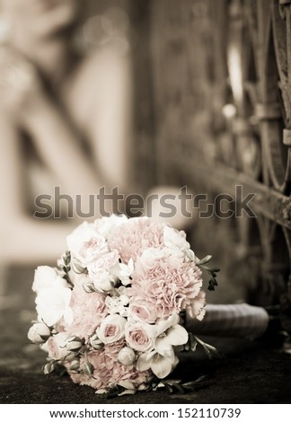 Beautiful white wedding bouquet in sepia tones - stock photo