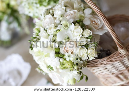Beautiful white wedding bouquets in basket