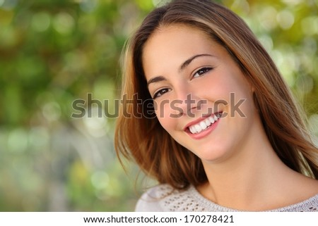 Beautiful white woman smile dental care concept with a green background - stock photo