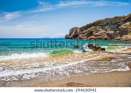 Beautiful wild beach with clear turquoise water and rocks. Malia, Crete island, Greece. - stock photo