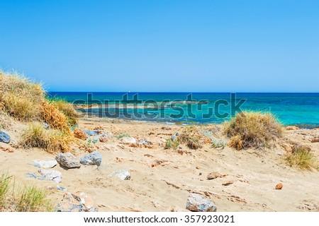 Beautiful wild beach with turquoise water and white sand. Crete island, Greece - stock photo