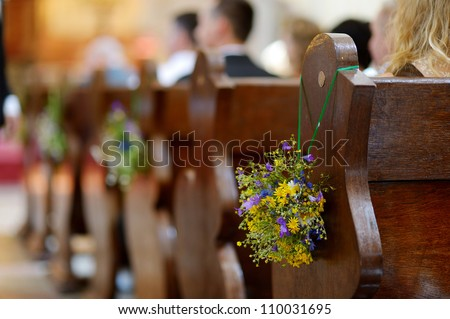 Beautiful wild flowers wedding decoration in a church - stock photo