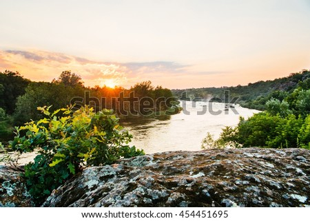Beautiful wild nature park, forest. Lake with mirror reflections and clear water on gold sunset light. Amazing wilderness rocks and mountains landscape panorama. Quiet river in summer. - stock photo