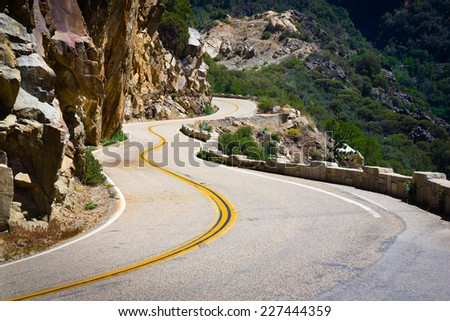 Beautiful winding road in mountains of Yosemite National Park, California