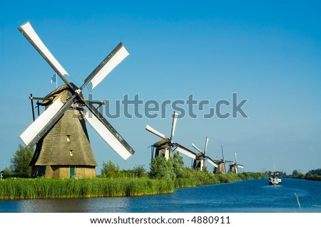 beautiful windmill landscape at kinderdijk in the netherlands - stock photo
