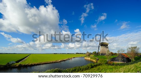 beautiful windmill landscape in the Netherlands, Schermerhorn, Schermer, Noord-Holland - stock photo