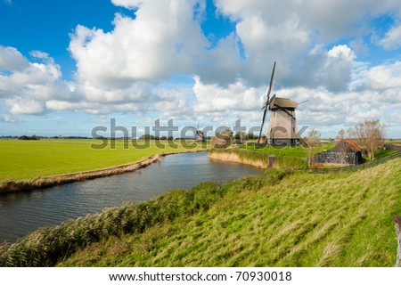 beautiful windmill landscape in the Netherlands, Schermerhorn, Schermer, Noord-Holland - stock photo