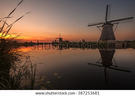 Beautiful windmills in Kinderdijk, Holland at sunset.