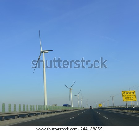 Beautiful windmills on the highway   - stock photo