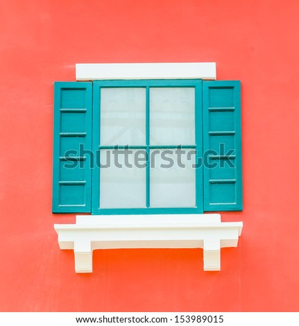 Beautiful window on color wall - stock photo