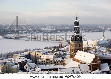 beautiful winter aerial panorama of Riga town with big cable bridge over Daugava river - stock photo