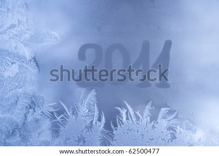 Beautiful winter background (frozen window with 2011 written on it) - stock photo