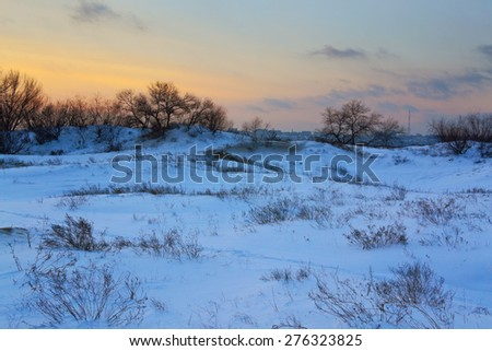 beautiful winter field sheltered snow at sunset - stock photo