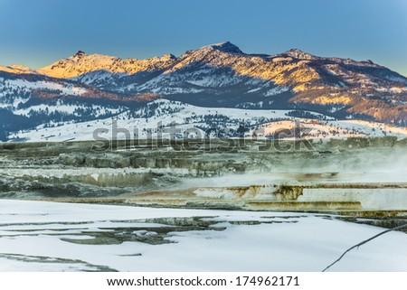Beautiful Winter Geyser at Sunset - Yellowstone National Park  - stock photo