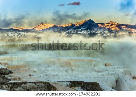 Beautiful Winter Geyser at Sunset - Yellowstone National Park  - stock photo