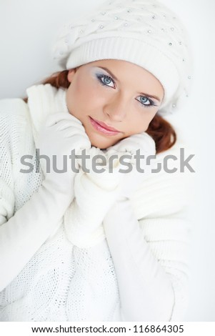 Beautiful winter girl wearing warm clothes and smiling - stock photo
