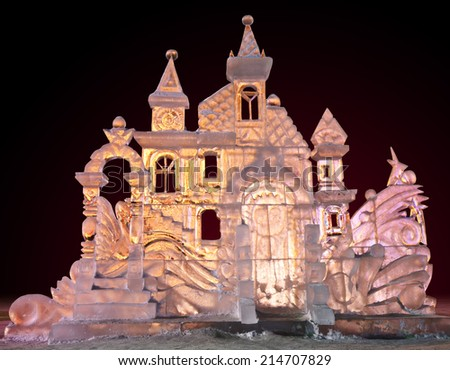 Beautiful winter ice sculpture of a frozen castle at the ice sculpture carving festival. - stock photo