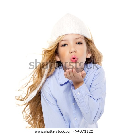 beautiful winter kid girl blowing wind with lips isolated on white - stock photo