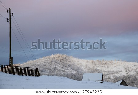 Beautiful winter landscape in the Carpathian mountains with roofs of houses