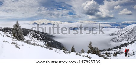 Beautiful winter landscape in the mountains with the sea of fog - stock photo