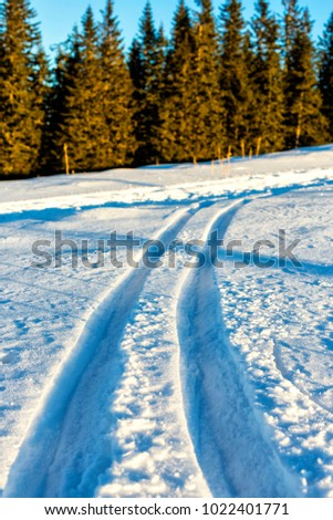 Beautiful winter landscape in the mountains with trail in the snow
