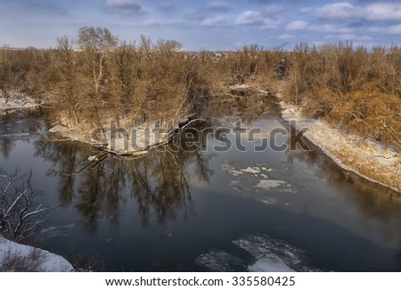 Beautiful winter landscape reflection of trees in water quiet river - stock photo