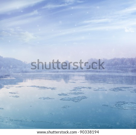 beautiful winter landscape - river during snowfall - stock photo