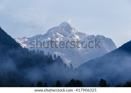 Beautiful winter landscape with fog covered trees at Litang County, Sichuan, China - stock photo