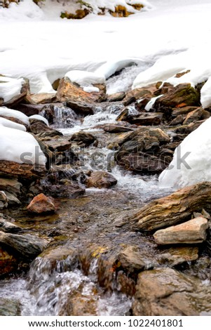 Beautiful winter landscape with frozen river