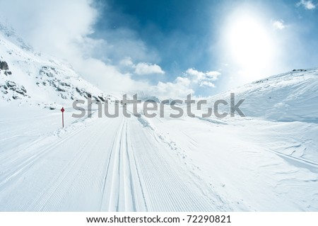 beautiful winter landscape with skiing tracks well groomed for cross country skiing - stock photo