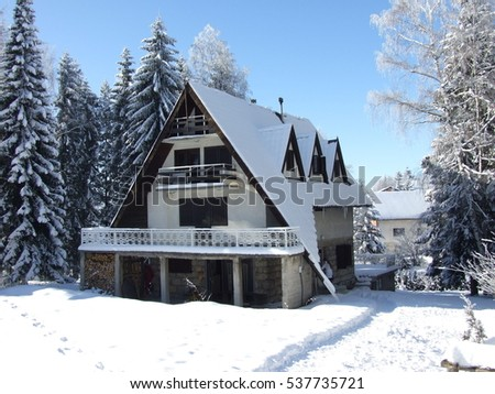Beautiful winter landscape with snow covered house.